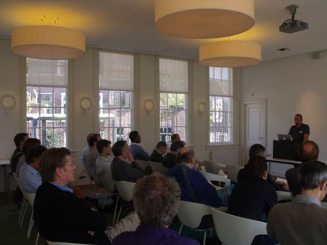 Audience listening to Timo Kracke's presentation on GOV.